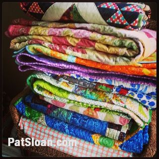 Pat sloan pile of quilts