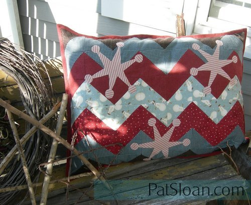 Pat sloan finished pillow on porch