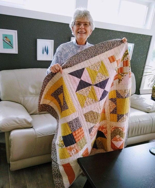 Pat sloan mom with her quilt
